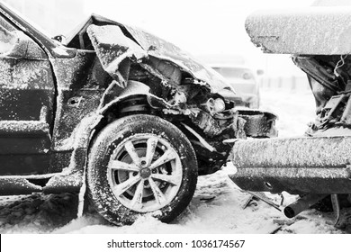 Crashed cars in accident on winter road with snow, black and white photo