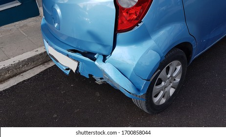 crashed damaged blue car in the rigth back side accident