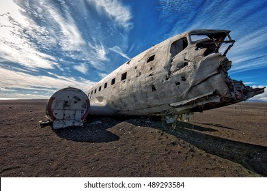 crashed plane, dc-3 airplane on a beach