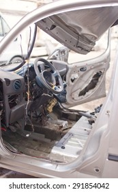 Crashed silver car inside view.