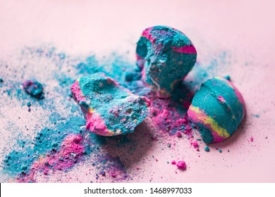 Crashed smashed cosmic colored frightful blue pink bath bomb on pink background, bath bomb with sparkles, fairy dust, close up