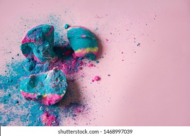 Crashed smashed cosmic colored frightful blue pink bath bomb on pink background, bath bomb with sparkles, fairy dust, copy space
