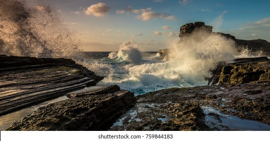Crashing sunrise waves on Oahu, Hawaii