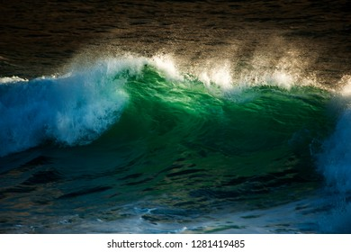 crashing wave with translucent green and spray