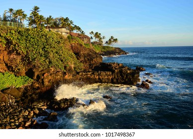 crashing waves against the rocks at poipu, kauai , hawaii