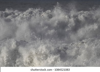 Crashing waves during storm. Northern portuguese coast. Focus on the foregroun.