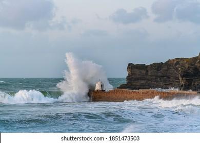 Crashing waves at Portreath, Cornwall in autumn