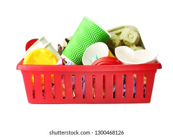 Crate with cardboard and plastic garbage on white background. Trash recycling