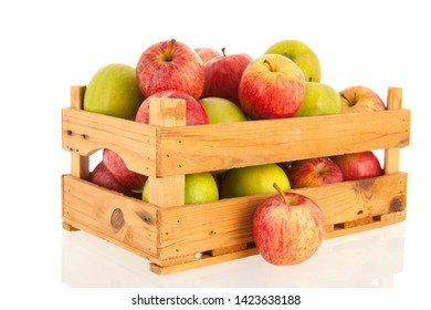 Crate fresh green and red apples isolated over white background