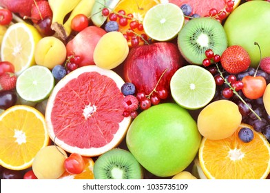 Crate of fresh ripe sweet fruits and berries, selective focus