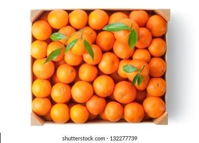 Crate of ripe tangerines. Top view. Isolated on a white.