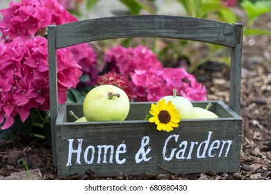 crate with the words Home and Garden in a garden