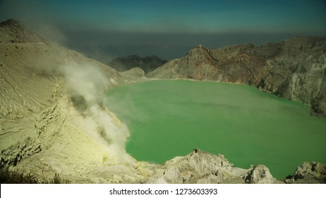 crater acid lake Kawah Ijen where sulfur is mined. Sulfur gas, smoke. mountain landscape Ijen volcano complex group of stratovolcanoes in East Java Indonesia