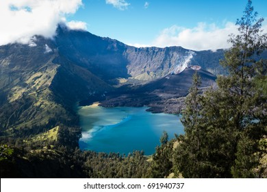 Crater, Anak Rinjani and lake view of Mount Rinjani from Senaru rim. Mount Rinjani is an active volcano in Lombok, Indonesia.