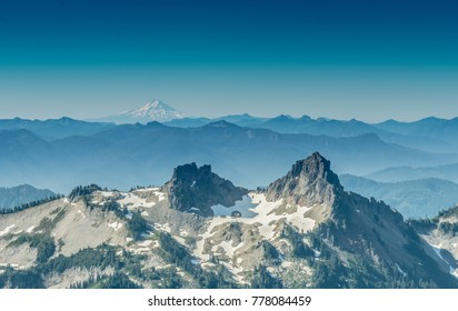 Crater in the Cascades Mountain Ridge with Mount Hood looming in distance