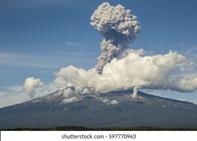 Crater fumarole among clouds of popocatepetl volcano in Mexico