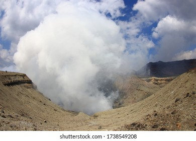 The crater of Mount Aso with much white smoke, in Kumamoto, Kyushu, Japan. The largest active volcano in Japan.