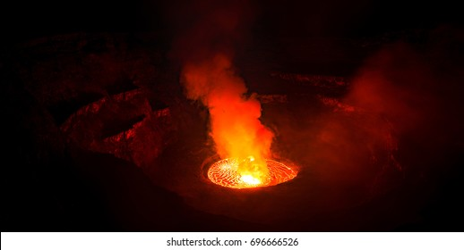 The crater of Mount Nyiragongo, at Volcanoes National Park in the Democratic Republic of Congo, lit only by the light of smoking molten lava of an active volcano at night