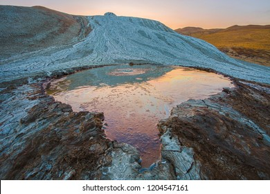 Crater of mud volcano. Sunset on the mud volcano. Mud volcanoes in Gobustan desert in Azerbaijan.