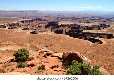 crater of stone monuments and pillars with palm shape in canyonlands