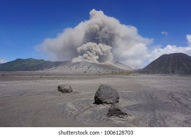 Crater view to smoking Mount Bromo volcano at Java, Indonesia