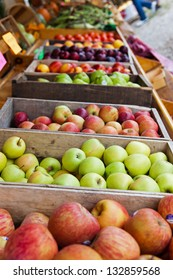 Crates of apples, plums and peaches are on display at a farmer's roadside stand market in northern Michigan. Crisp Michigan apples are always a treat in autumn