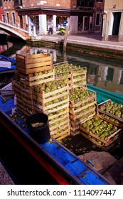 Crates of artichokes on a canal boat in Venice, Italy