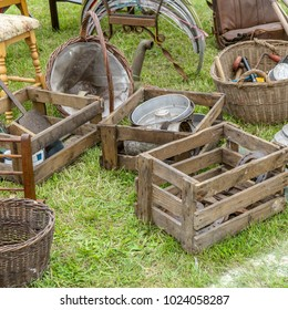 Crates, baskets, furniture and household items at a flea market