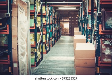 Crates and boxes on a shelves in a warehouse .