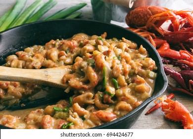 Crawfish étouffée being served in a cast iron skillet.