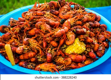 Crawfish Boil Colorful Seafood Outdoor Party Spicy Corn Cajun Craw Daddy's amazing tasty spice of Louisiana Texas Cajun Sea Food Lots of Corn and onion and spice
