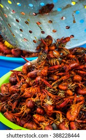Crawfish Boil Colorful Seafood Outdoor Party Spicy Corn Cajun Craw Daddy's amazing tasty spice of Louisiana Texas Cajun Sea Food with cooking pot