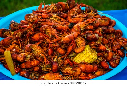Crawfish Boil Colorful Seafood Outdoor Party Spicy Corn Cajun Craw Daddy's amazing tasty spice of Louisiana Texas Cajun Sea Food blue bowl outdoor party