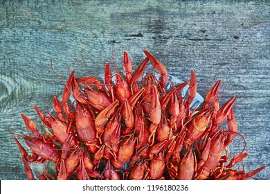 Crawfish cooked and served on wooden background