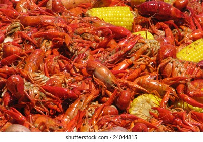 Crawfish and corn spreadout on a table.