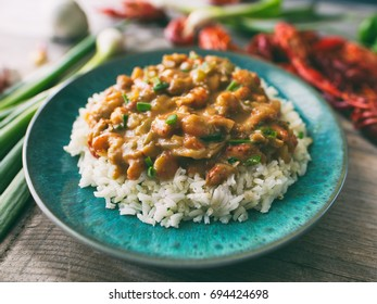 Crawfish étouffée served on a bed of rice.