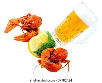 Crawfishes and mug of beer isolated on white