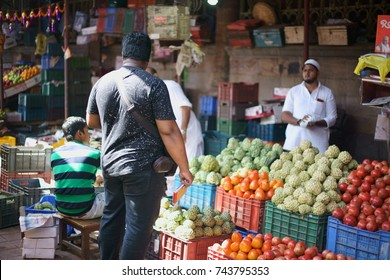 Crawford Market, Dhobi Talao, Chhatrapati Shivaji Terminus Area, Fort, Mumbai, Maharashtra, India - October 25, 2017 - A  man/ customer is seen buying fruits from a local shopkeeper in the market