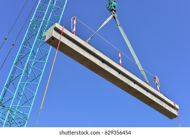 Crawler Crane lifting Hollow core slab for installation with blue sky background