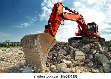Crawler excavator on demolition site. Front view of a big crawler excavator working on demolition site.