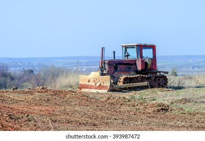 crawler tractor on a background of blue sky