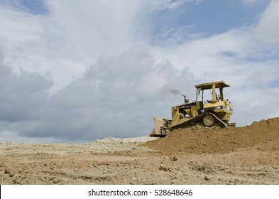 Crawler Tractor soil pushing with blue sky background.