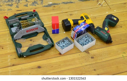 Crawley,West Sussex/ United Kingdom-February 1 2019:  A selection of work tools and fasteners to repair loose floorboards