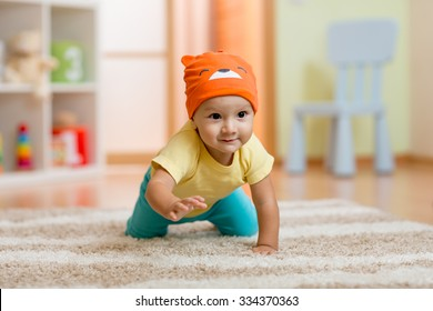 crawling baby boy at home on floor