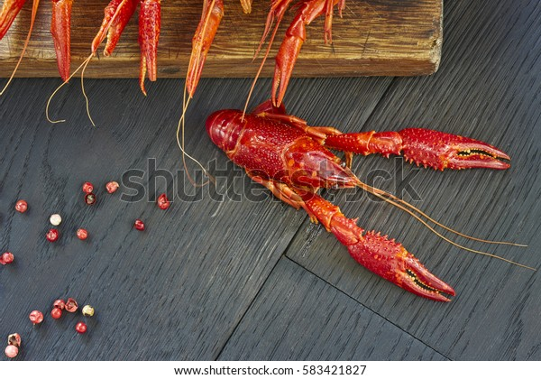 Crayfish. Delicious, Boiled, red crawfishes on a dark wooden table, close-up.