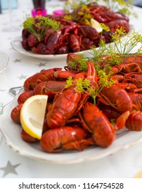 Crayfish on plate with a lemon slice