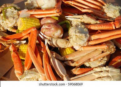 Crayfish and opilio crab legs with hearty vegetables medley served at dusk with shallow DOF