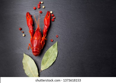 Crayfish red, Baby Lobster with herb for stir fry on black slate plate