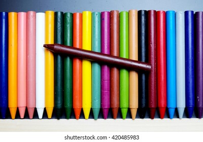 Crayon drawing on blackboard and a brown at top. Dark tone.Focus on brown.