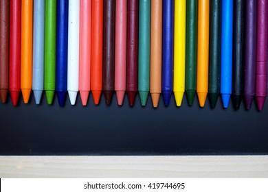 Crayon drawing on blackboard. Dark tone. Space or texts.